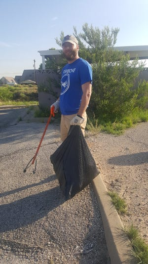 Carlsbad Current-Argus Reporter Adrian Hedden gets ready to pick up trash, June 8, 2019 at the Carlsbad Mall.
