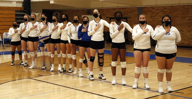 The Carlsbad Cavegirls stand for the Star Spangled Banner before their final home match of the season against Clovis on March 23, 2021.