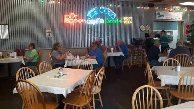Artesia residents enjoy indoor dining at the Chaos Cafe in Artesia on March 12, 2021.