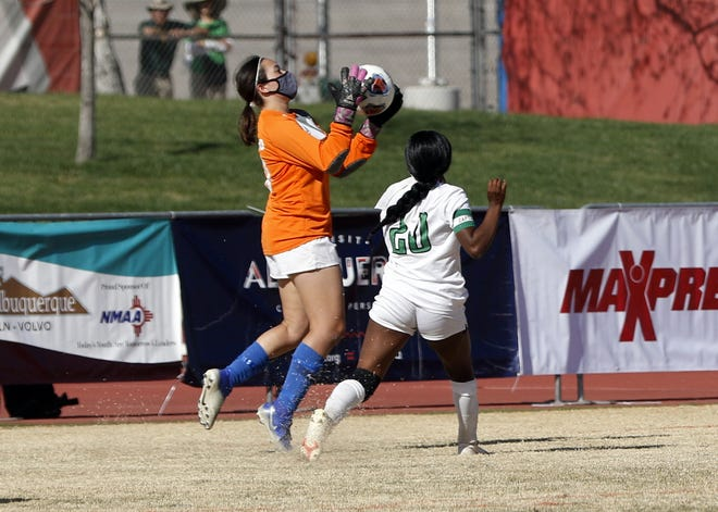 Carlsbad goalie Korrine Bradford makes one of her saves in the final two minutes of the Class 5A state championship girls soccer game against Albuquerque on April 10, 2021. Carlsbad won, 1-0 and finished the season a perfect 11-0.