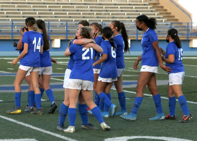 The Cavegirls celebrate their 5A semifinal win against Rio Rancho on April 8, 2021. Carlsbad won, 3-2 and advances to the state title for the first time in school history.