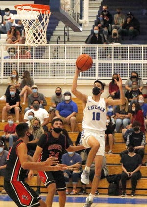 Damien Perez takes a jump shot against Roswell on April 16, 2021. Perez finished with seven points.