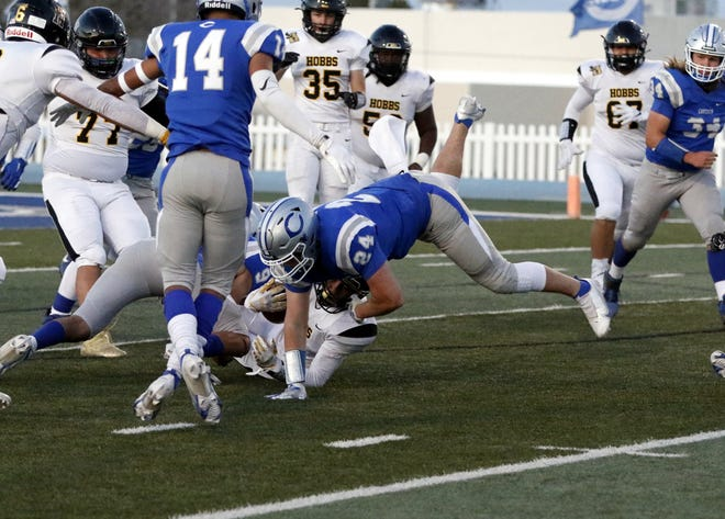 Carlsbad senior Kody Daniell (24) brings down a Hobbs runner in the first quarter of their Senior Night game on March 19, 2021. Daniell recorded an interception and Carlsbad won, 27-21.