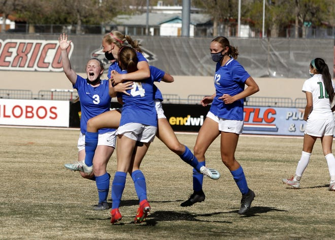 The Carlsbad Cavegirls celebrate Alexa Dugan's (4) game-winning goal against Albuquerque High in the final minute of the Class 5A girls state championship game on April 10, 2021. Carlsbad won, 1-0 and finished the season a perfect 11-0.