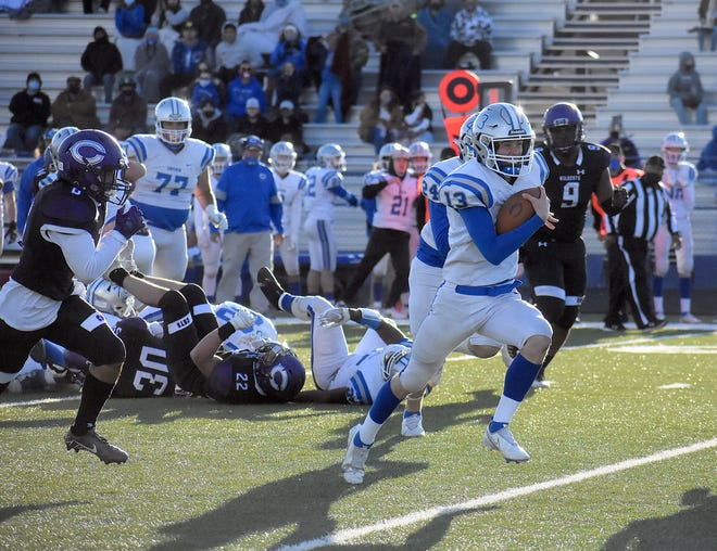 Carlsbad quarterback Dane Naylor scrambles for a 34-yard touchdown run against Clovis on March 27, 2021. Naylor led the Cavemen in passing this season with 368 yards and four touchdowns.
