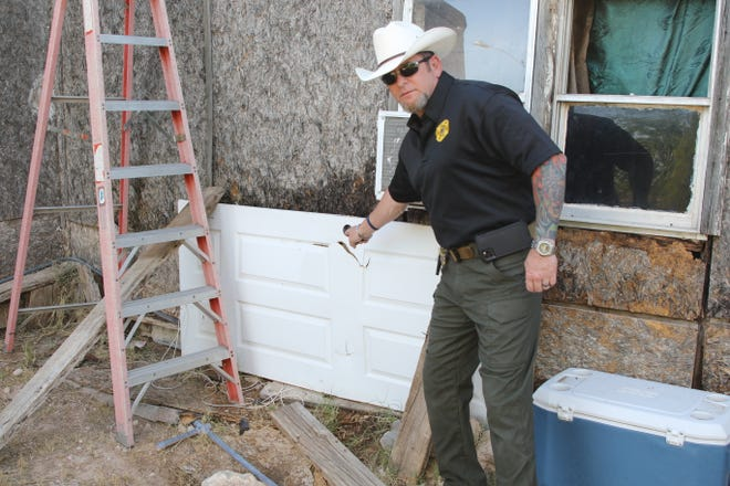 Eddy County Sheriff Mark Cage points to an alleged surveillance camera during a June 12, 2020, drug raid in Carlsbad.