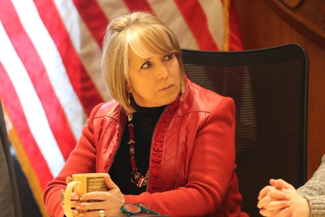 New Mexico Gov. Michelle Lujan Grisham speaks with Carlsbad's Bat Brigade, Feb. 4, 2020 at the Roundhouse.