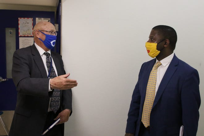 Carlsbad Municipal Schools Superintendent Dr. Gerry Washburn (left) visits with New Mexico Public Education Department Secretary Ryan Stewart during a visit to Carlsbad High School on Feb. 9, 2021.