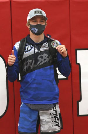 Dallas Dunn displays his District 3-5A wrestling medal in the 120-pound division on May 21, 2021. Dunn will return to the state tournament for the second consecutive year.