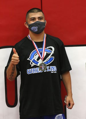 Matthew Najera displays his District 3-5A wrestling medal in the 138-pound division on May 21, 2021. Najera will return to the state tournament for the third consecutive year.