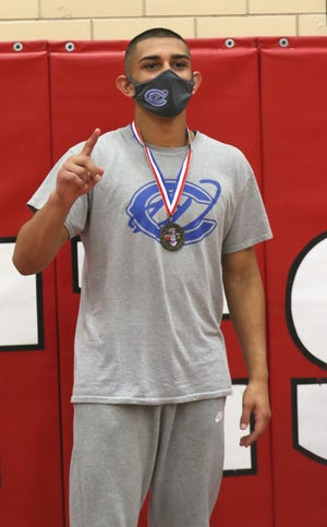 Jacob Fuentes displays his District 3-5A wrestling medal in the 182-pound division on May 21, 2021. Fuentes will return to the state tournament for the second consecutive year.