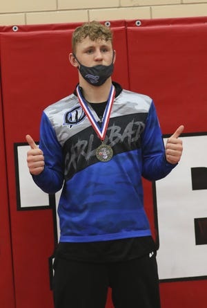 """Trystan """"TJ"""" Rogers displays his District 3-5A wrestling medal in the 170-pound division on May 21, 2021. Rogers will return to the state tournament for the second consecutive year."""