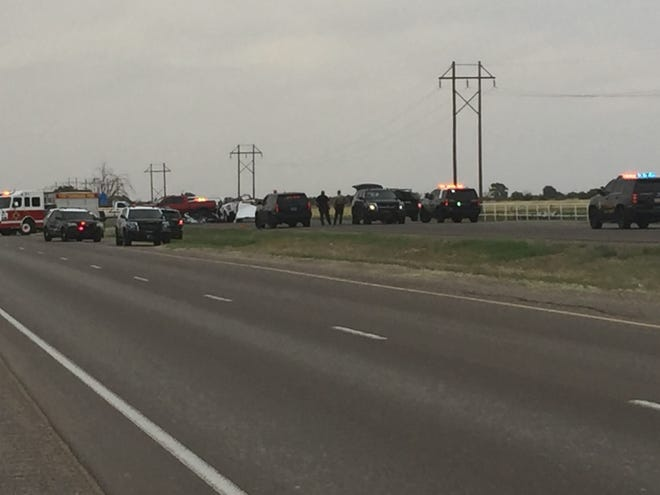 Officials from the New Mexico State Police and Eddy County Sheriff's office investigated a crash scene north of Artesia on May 21, 2021. State police said an Artesia officer was killed during a crash with a semi.