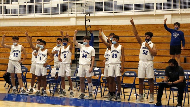 Carlsbad's bench stands for its team's free throw routine against Roswell on April 15, 2021. The Cavemen finished the season 8-4 and had to forfeit its tournament game due to a COVID-19 outbreak.