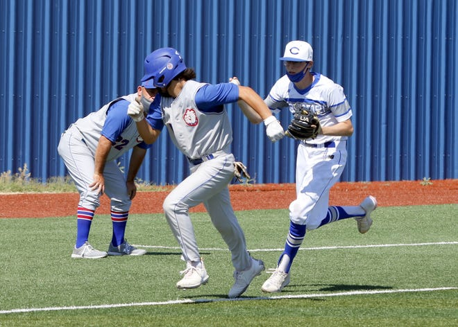 Las Cruces' Demitrius DiMatteo is caught in a rundown against Carlsbad in Game 2 of their doubleheader against Carlsbad on May 1, 2021. Maddux Edmonson, right, tagged out DiMatteo and Carlsbad won both games by a combined 17-3 margin.