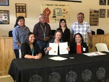 New Mexico State Land Commissioner Stephanie Garcia Richard (center) presents and executive order to block oil and gas lease sales near Chaco Canyon.