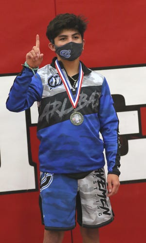 Marcus Najera displays his District 3-5A wrestling medal in the 106-pound division on May 21, 2021. Najera will return to the state tournament for the third consecutive year.