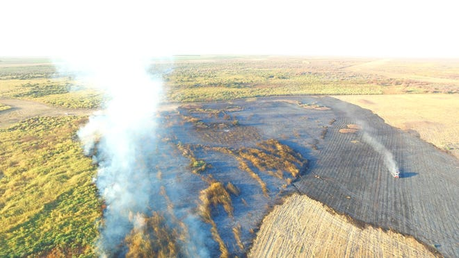 A photograph from an Artesia Police Department drone shows a major brush fire burning in the old Lake McMillan bed on Oct. 16, 2020. Eddy County Commissioners approved a fire excise tax purchase for new software for Eddy County's Emergency Operations Center.