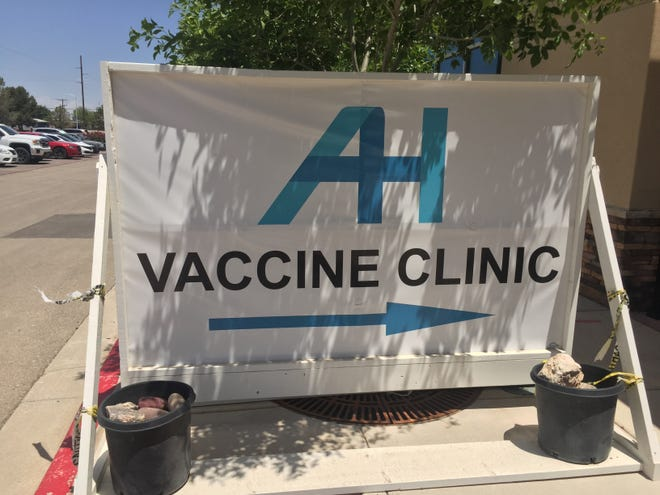 A sign at Artesia General Hospital indicates the location of the COVID-19 vaccination clinic.