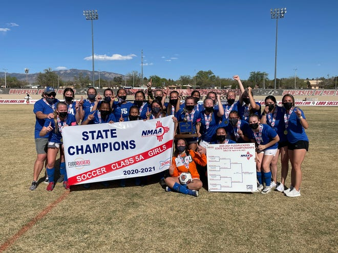 The Carlsbad Cavegirls celebrate winning the Class 5A girls soccer title against Albuquerque High on April 10, 2021. Carlsbad won, 1-0 and finished the season a perfect 11-0.