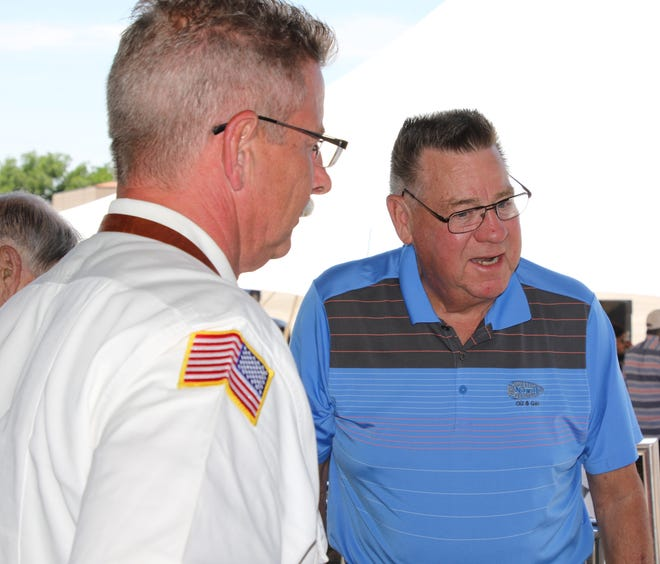 Artesia Fire Chief Kevin Hope (left) and former Carlsbad Municipal Schools Superintendent Vernon Asbill visit at the Tunnel to Towers 9/11 Memorial Exhibit June 11, 2021 in Artesia.