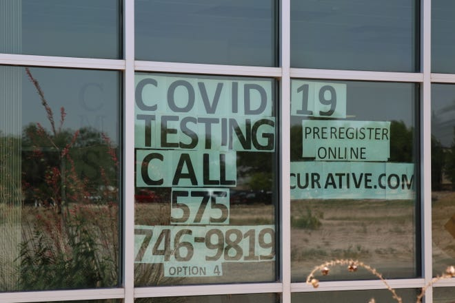 A sign at the Eddy County Public Health Office in Artesia reminds people to get tested for COVID-19 on June 16, 2021.