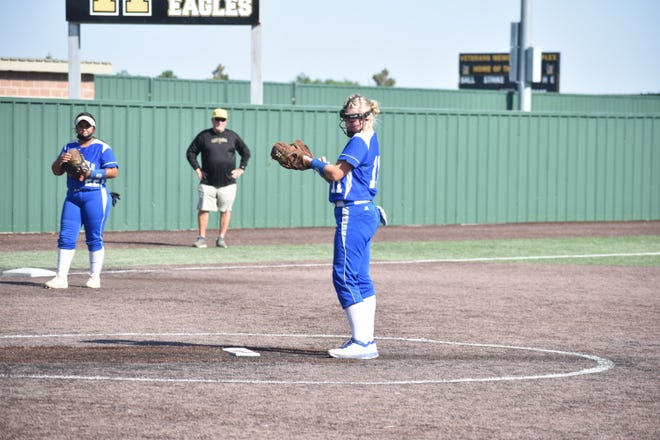 Carlsbad starting pitcher Haven Schoolcraft checks her armband Thursday night during the first inning of a softball game against Hobbs at Veterans Memorial Complex.