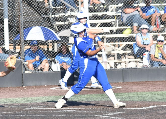 Mariah Torres connects for a two-run homer against Hobbs. Carlsbad swept the season series and claimed the district title.