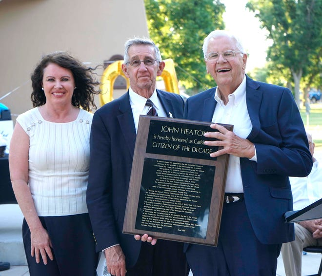 John Heaton (right) is presented with the Citizen of the Decade award by Carlsbad Mayor Dale Janway (center) and Deputy City Administrator Wendy Austin during the Spirit of Carlsbad award ceremony, June 17, 2021 at the Carlsbad Beach Band Shell.