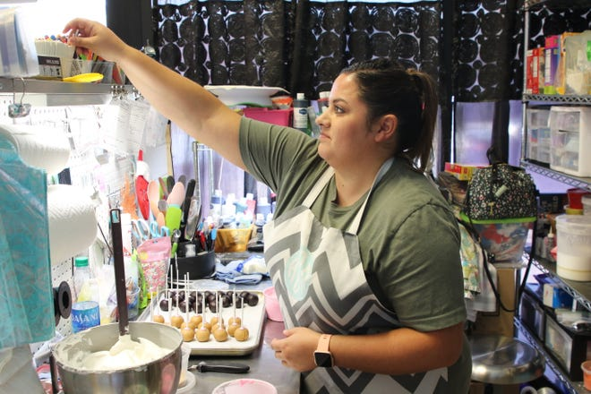 Kayla Dominguez of Sweet Confections in Artesia makes sweet treats on June 22, 2021. As of July 1, businesses in Eddy County and New Mexico are no longer under COVID-19 restrictions.