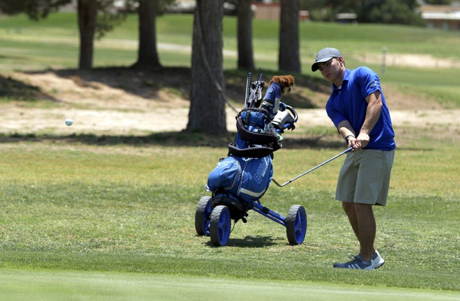 Carlsbad senior Eli House hits a ball on the 13th hole at the Riverside Country Club in the District 4-5A Tournament on June 7, 2021. House shot a 79 and will compete in the New Mexico state golf championships in Albuquerque on June 21.