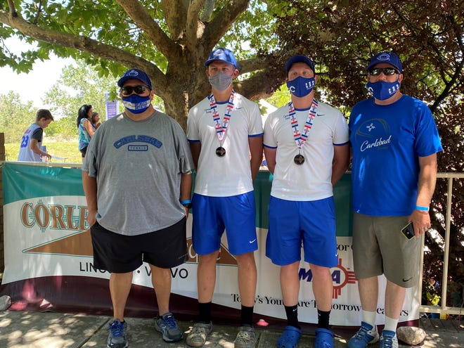Left to right: Carlsbad tennis head coach Ryan Galindo, seniors Clayton Bluth and Andrew Miller and assistant coach Scot Bendixsen pose after Miller and Bluth won 2nd place in the 5A boys tennis doubles championship in Albuquerque on June 12, 2021.