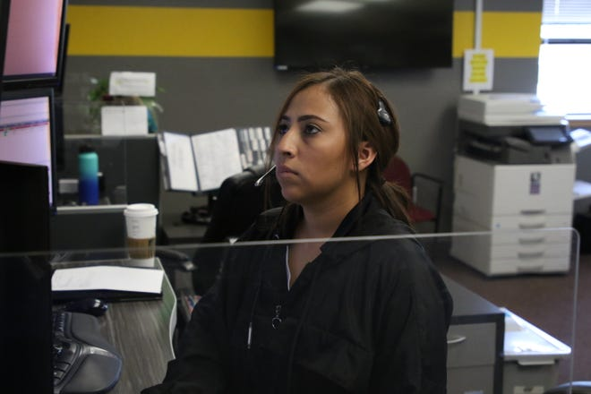 Olivia Molina takes a call at the City of Carlsbad's Emergency Dispatch Center. A state grant allowed the City to upgrade its emergency phone system.