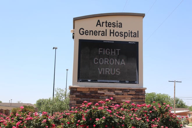A sign at Artesia General Hospital reminds Eddy County residents to fight COVID-19 on June 16, 2021.
