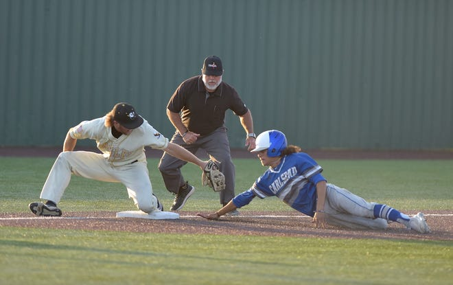 Carlsbad's Sack Marquez slides into third base during the 5A quarterfinals game against Hobbs on June 22, 2021. Hobbs won, 4-1.