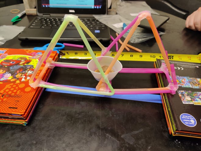 During the Inspired by Science 2020 summer camp, participants learned about physics in the bridge building challenge.
