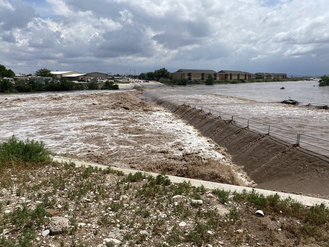 Flooding of Dark Canyon at San Jose Blvd on June 29 closes the intersection and causes flooding of Pecos River in Carlsbad.