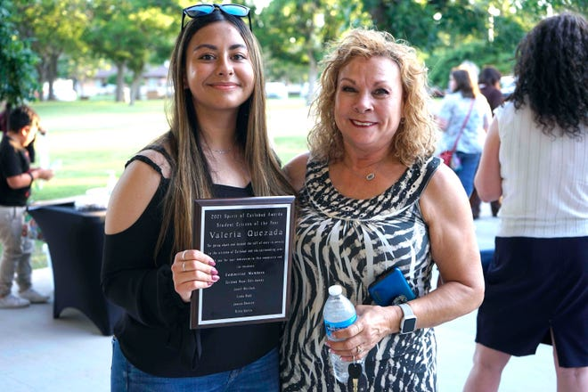 Valeria Quezada (left) is presented with the Student Citizen of the Year award during the Spirit of Carlsbad award ceremony, June 17, 2021 at the Carlsbad Beach Band Shell.