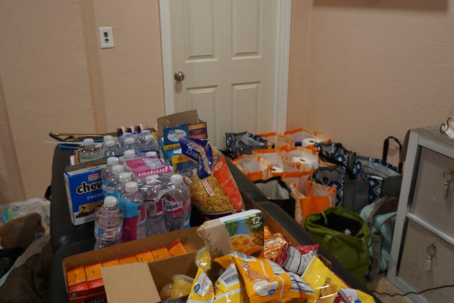 """Vanity Ink'd put together 32 """"blessing bags,"""" on July 1, 2021, that will be distributed to help homeless people in Carlsbad, New Mexico, affected by the recent flood."""