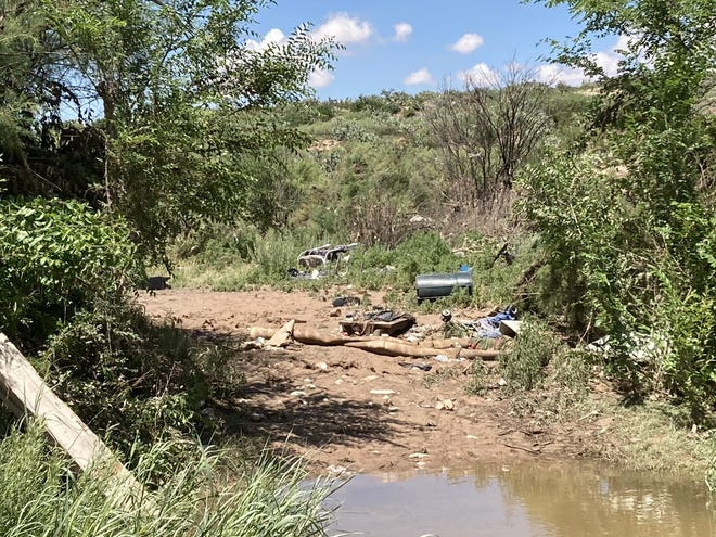 Trash and debris are all that left days after a flash flood swept away a homeless encampment in Southern Carlsbad.