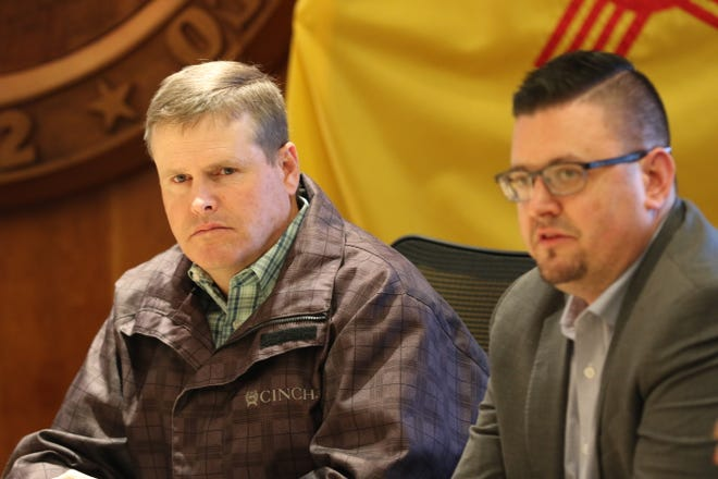 Eddy County Community Services Director Wes Hooper (left) and Carlsbad City Councilor Jason Shirley attend a meeting with New Mexico Gov. Michelle Lujan Grisham, Feb. 4, 2020 in Santa Fe.