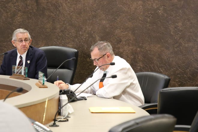 Carlsbad Mayor Dale Janway (left) listens to City Administrator John Lowe address the City Council on Aug. 25, 2020.