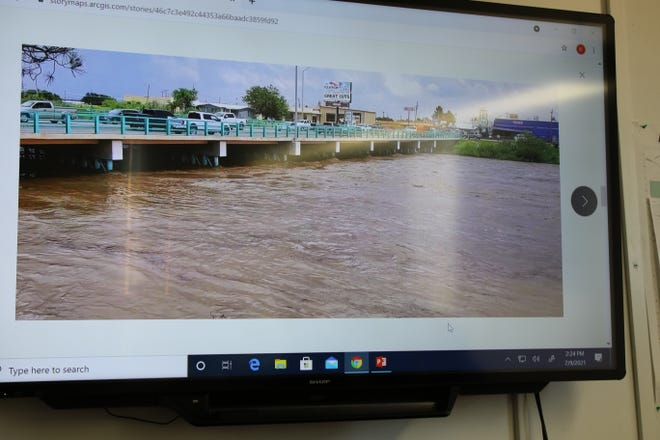 Lt. Gov. Howie Morales and Carlsbad city officials view video of flood waters raging through Carlsbad on June 29, 2021.