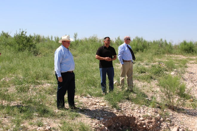 From left: City of Carlsbad Deputy City Administrator KC Cass, Lt. Gov. Howie Morales and Scott Hicks of Smith Engineering survey damage from June floods in Carlsbad on July 9, 2021.