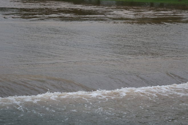 Flood waters drift down the Eagle Draw flood channel in Artesia on the morning of June 29, 2021. A flash flood watch was posted until 6 p.m.