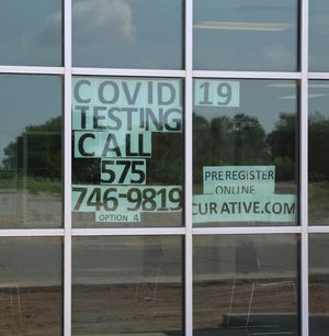 A sign at the Eddy County Public Health Office in Artesia reminds people to get tested for COVID-19. Eddy County had 59 new cases over the weekend.