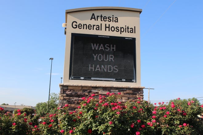 A sign at Artesia General Hospital encouraged Eddy County residents to wash their hands on July 30, 2021. New Mexico Department Health cited concerns in rising COVID-19 cases in Eddy County.