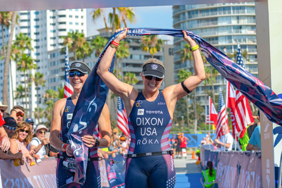 Amy Dixon raises her arms in celebration after winning the 2019 USA Triathlon Paratriathlon National Championships in Long Beach