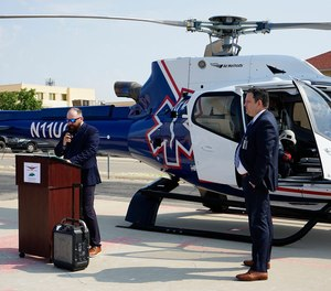 Clint Burleson, regional air manager of Native Air, addresses community members and employees of Carlsbad Medical Center during a ceremony July 22, 2021. Nick Arledge, chief executive officer of Carlsbad Medical Center looks on.