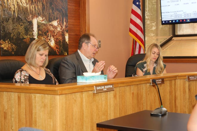 From left: Eddy County Clerk Darlene Rosprim, Eddy County Manager Allen Davis and District 5 Eddy County Commissioner Sarah Cordova listen to an update on May budget numbers on July 6, 2021.